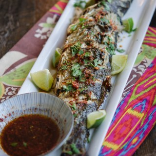 Grilled Fish is served with Soy Lime Chili Sauce and lime wedges