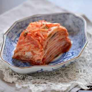 Korean cabbage kimchi is sliced beautifully on a serving dish