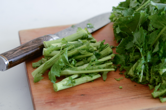 Cut off the fibrous part of Broccoli Rabe