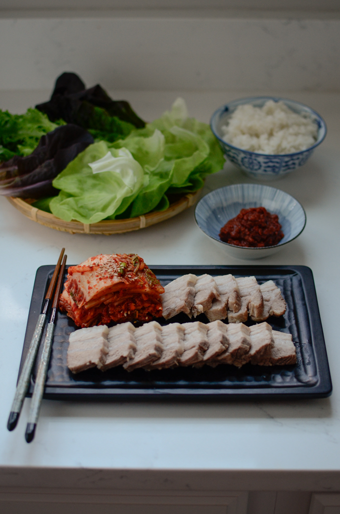 Bossam (Korean boiled pork) is served with kimchi and lettuce