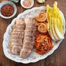 Bossam (Korena pork belly wraps) are arrange in a platter to serve