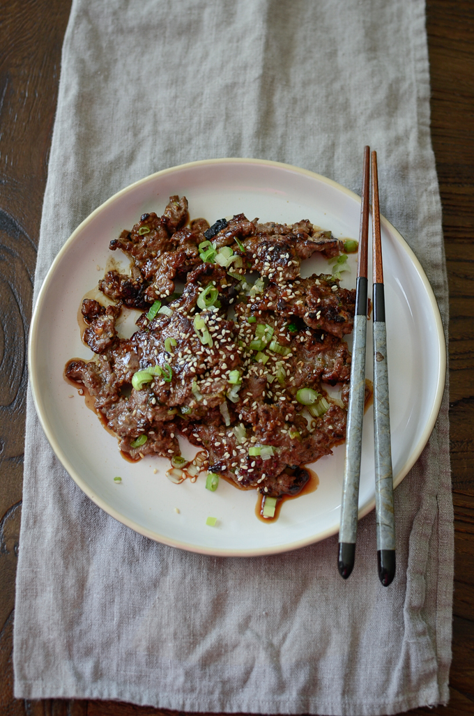 Crispy Korean Beef is ready to serve with a pair of chopsticks.