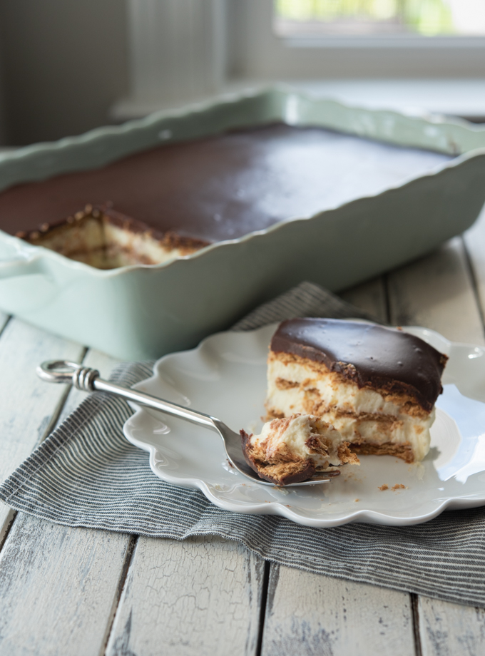 No need to bake chocolate eclair cake made from scratch with graham crackers, vanilla custard, and chocolate ganache.