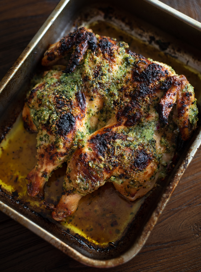 Devil's chicken is a roasted spatchcock chicken rubbed with butter parsley paste
