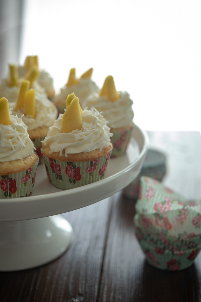 Mango cupcakes are lined with floral cupcake liners