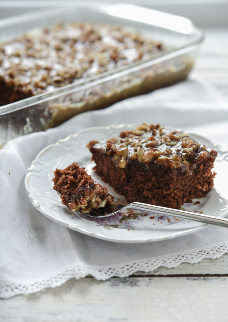 A slice of chocolate oatmeal cake is on a plate with a fork