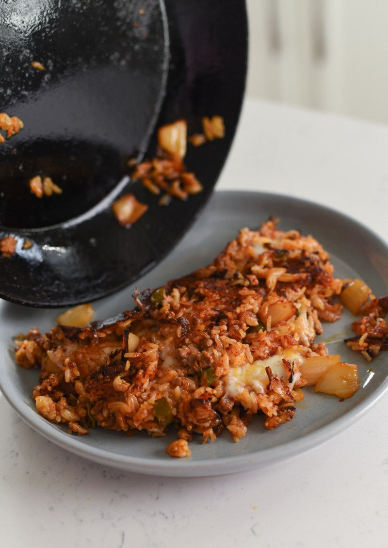 Put kimchi frie drice on a plate folding in half as you slide in