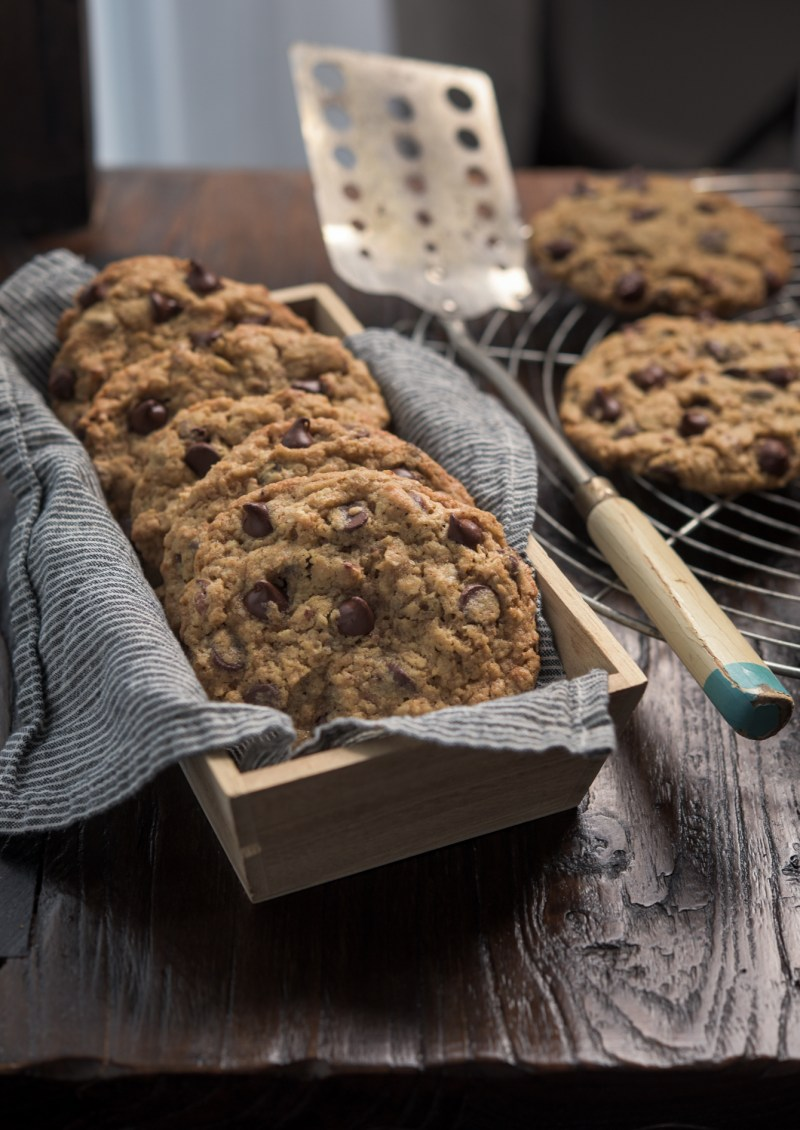 Wheat germ chocolate chip cookies are stacked together in a box