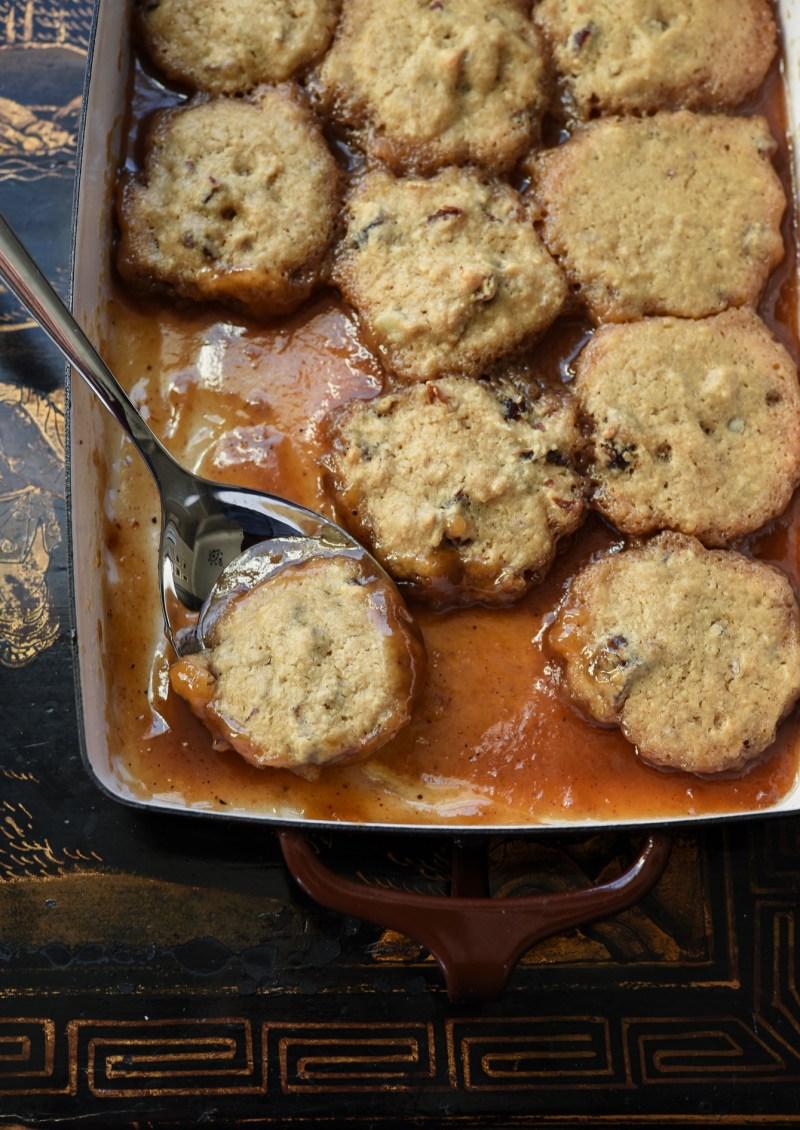 soft date dumplings are nestled in sweet brown sugar syrup