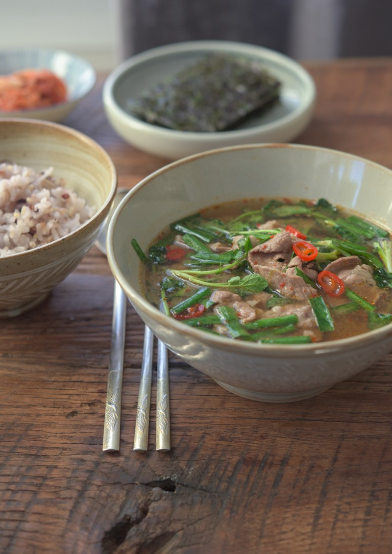 This Korean soybean paste soup with beef and watercress is served with rice and kimchi