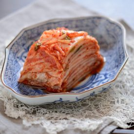 Beautifully sliced cabbage kimchi is served in a dish
