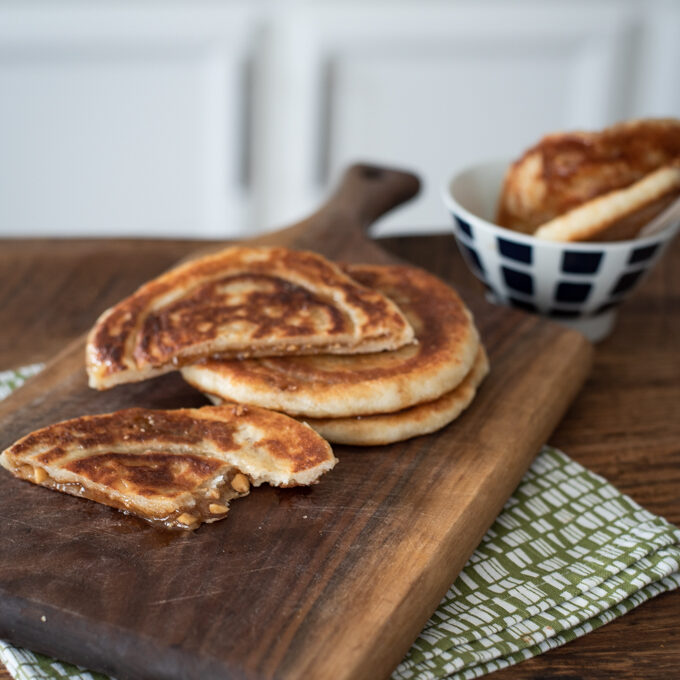 Hotteok is Korean sweet pancakes with cinnamon brown sugar filling