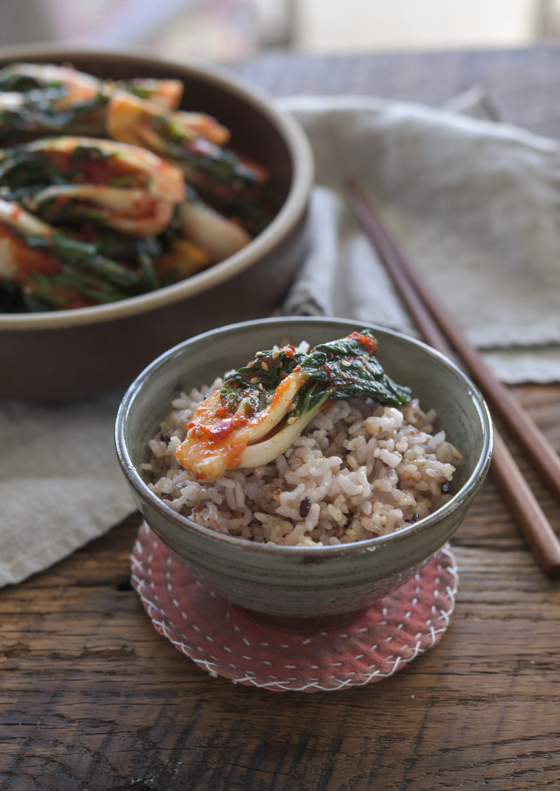 Bok choy kimchi is served with rice.