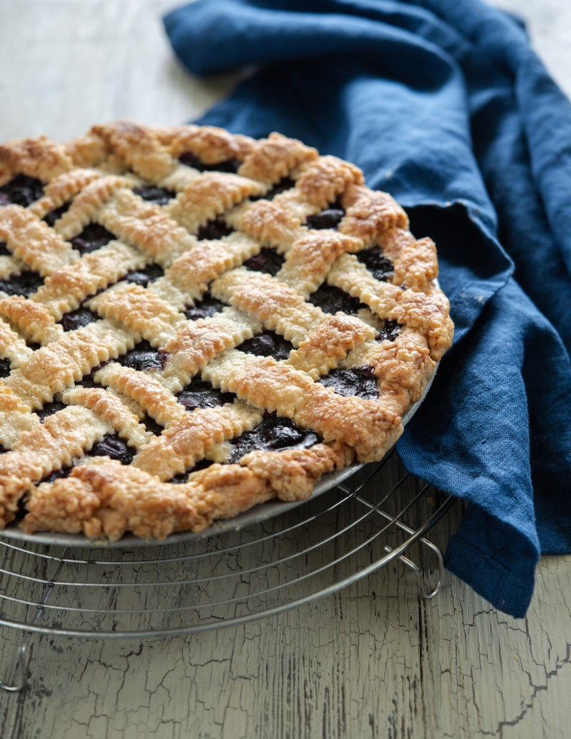 Maple blueberry pie is baked in a light and flaky lard and butter pie crust.