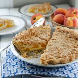 Peach and creamy custard makes a tasty pie, especially with the streusel topping