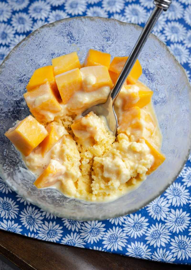 Cool and refreshing shaved ice dessert is topped with mango pieces
