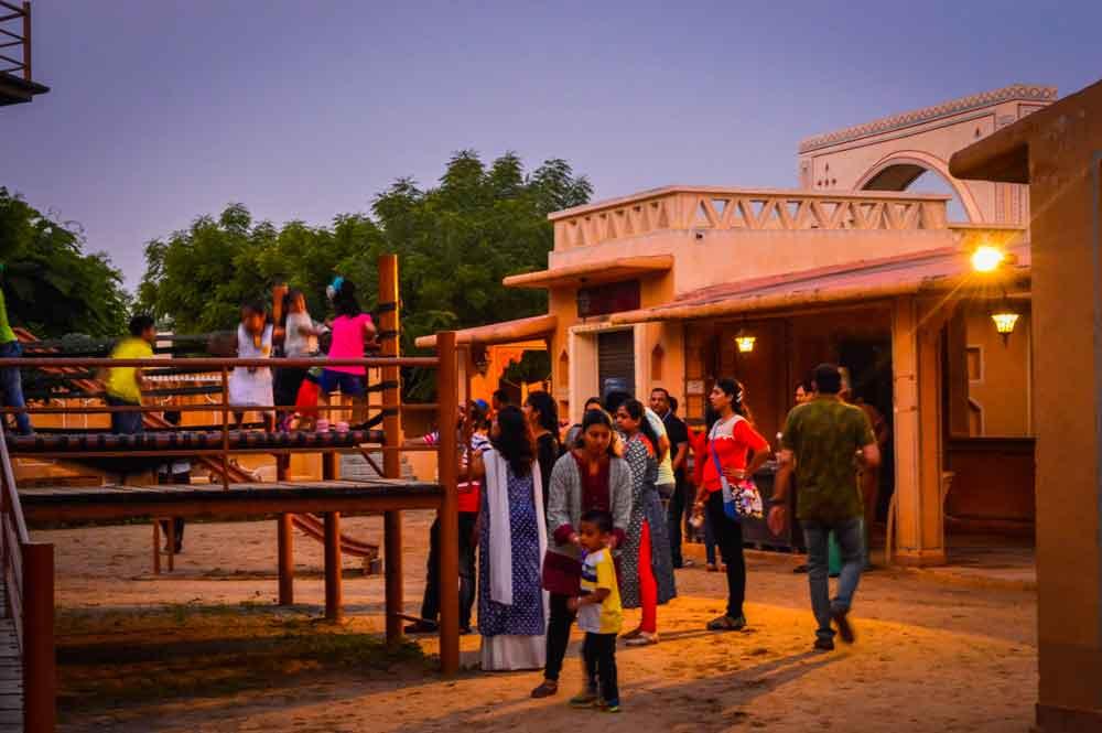 People enjoying a Jaipur tourist village
