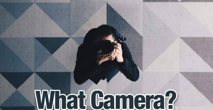 A Photographer taking photograph in a ceiling mirror