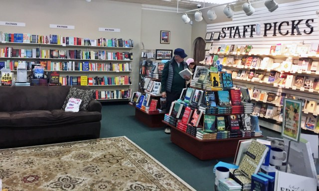 Staff Picks and a sofa to read on at The Doylestown Bookshop.