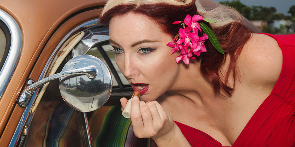 Hawaii Conceptual Portrait pinup photography woman applying lipstick in car mirror