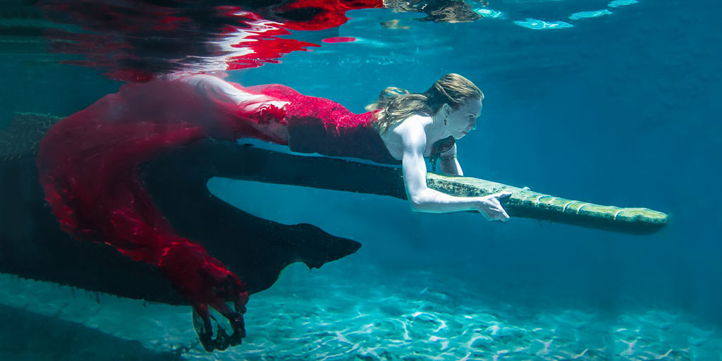 Hawaii Conceptual Portrait underwater woman in red gown