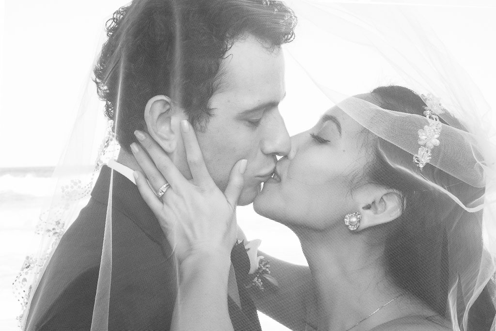 Hawaii wedding black and white bride and groom closeup kiss with veil professional photographer
