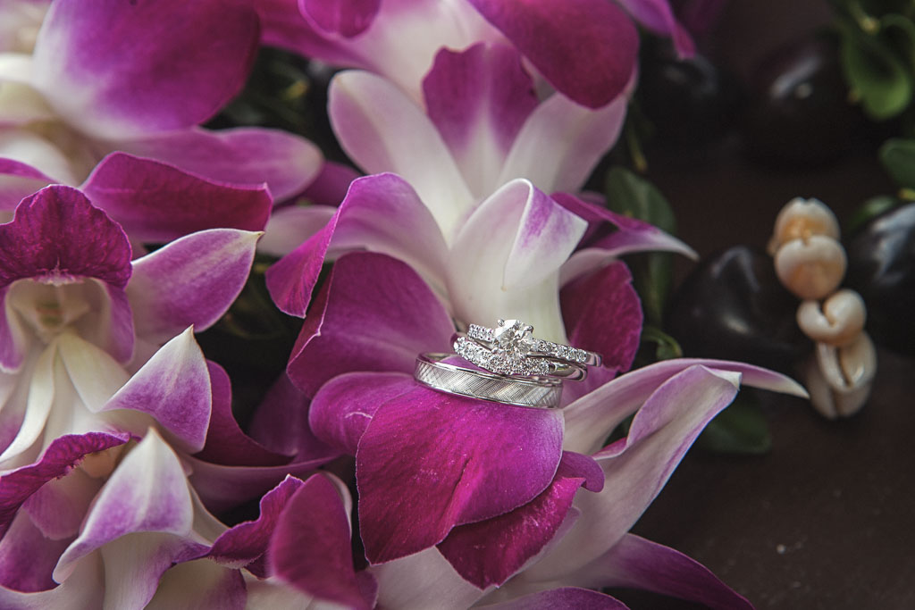 Hawaii wedding rings with orchid leis professional photographer