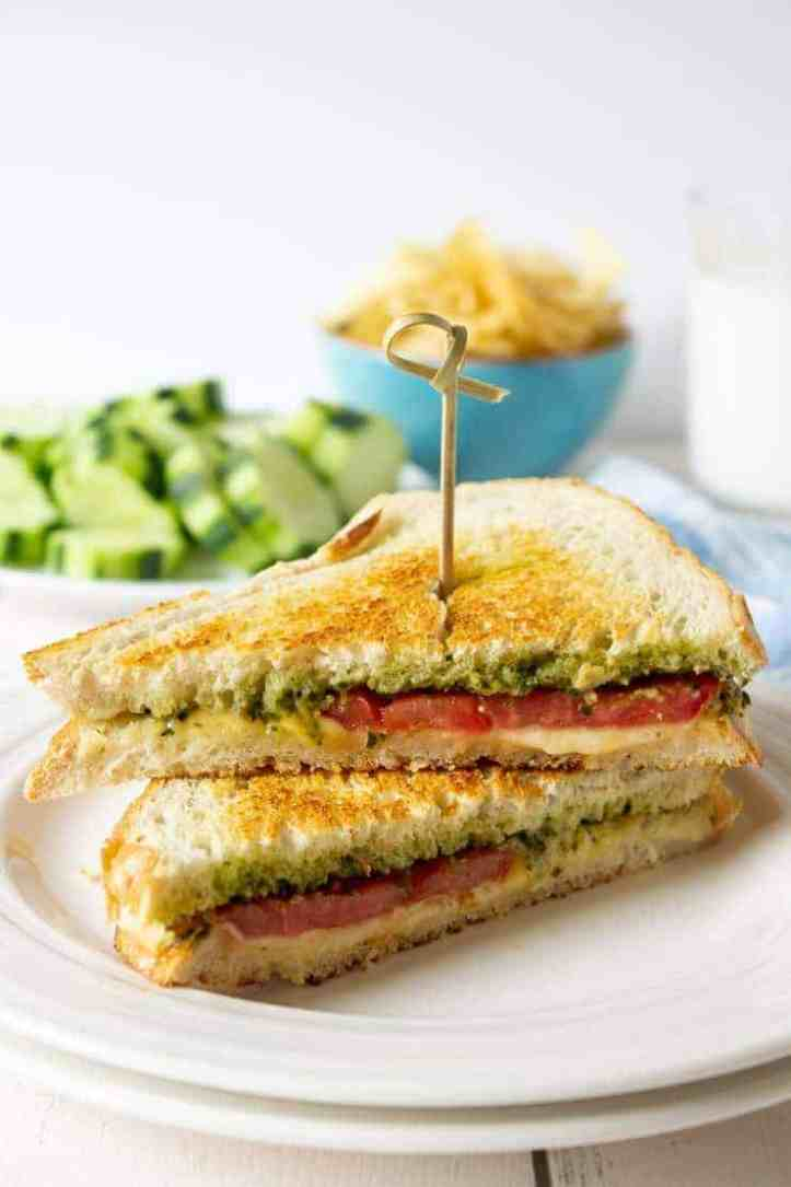 Pesto Grilled Cheese Sandwich made with pesto, gouda cheese, and garden fresh tomatoes.