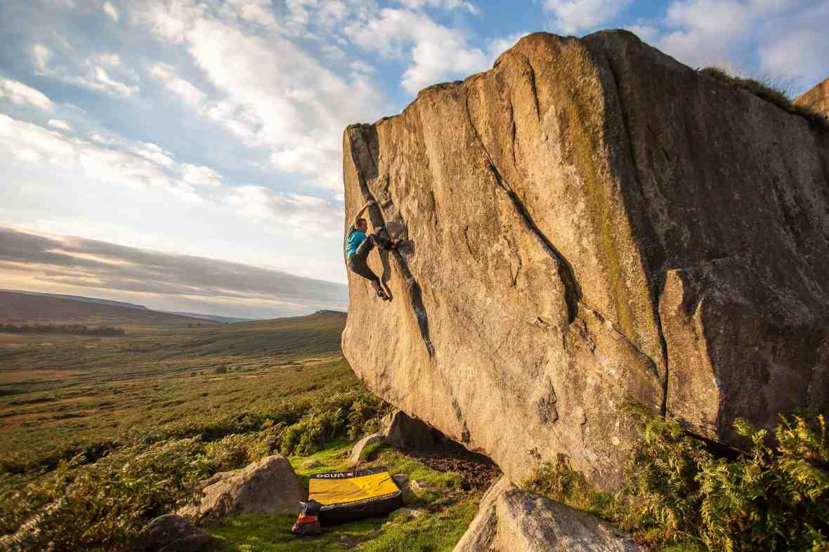 A man bouldering at Stanage