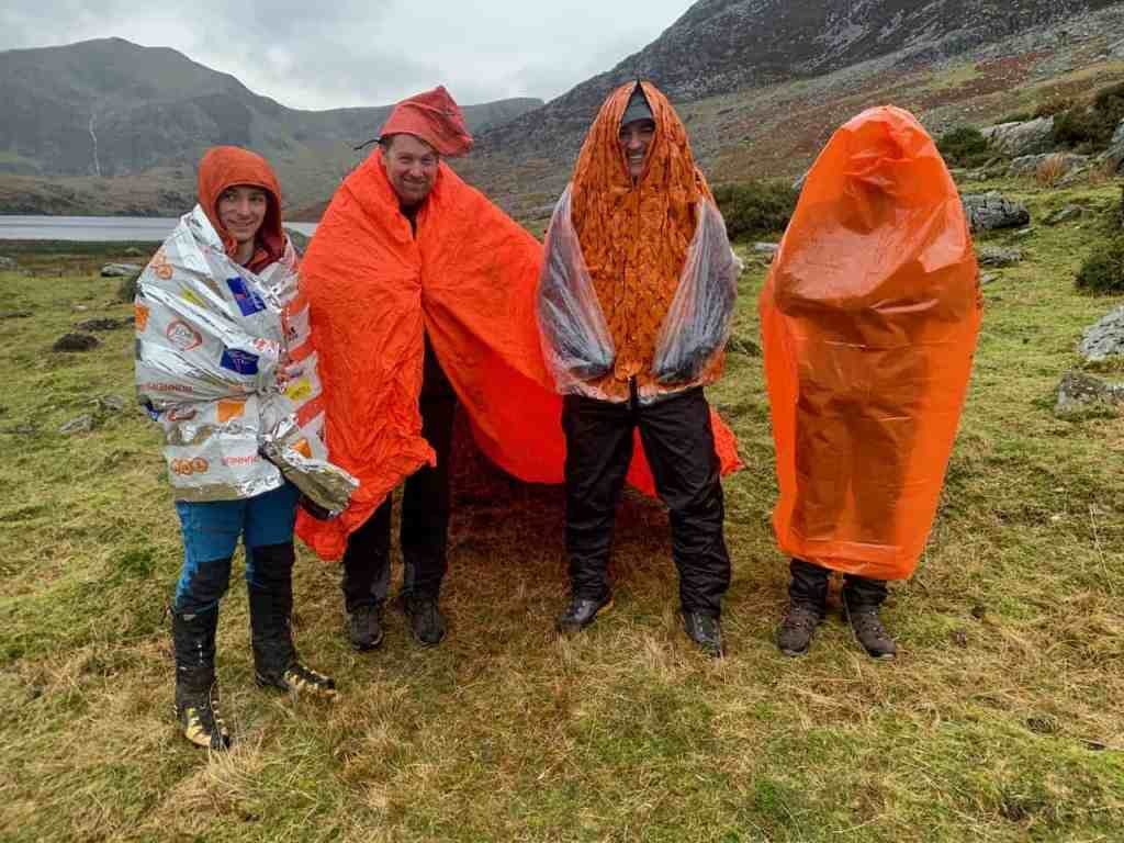 A range of emergency shelters being experimented with on a Mountain Leader Training course in Snowdonia.