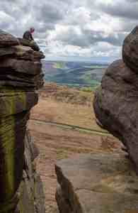 Climber belaying at the top of Stanage Edge © Luke Fletcher