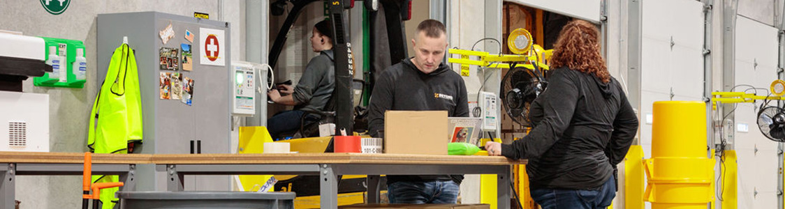 Employees working in the warehouse.