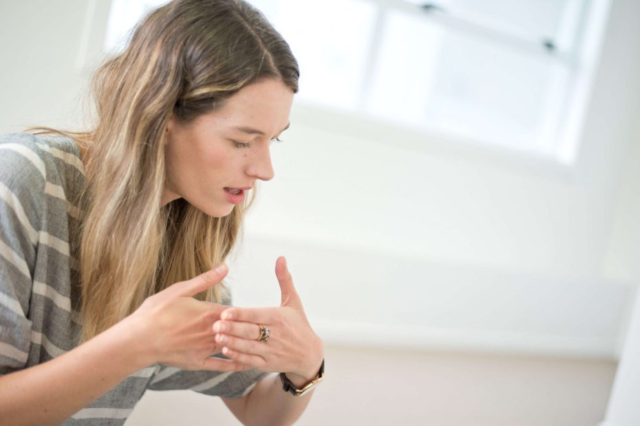 Speech Language Therapist Doing Makaton Sign