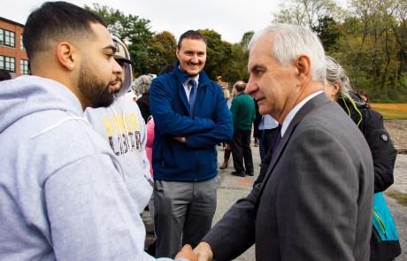 Senator Reed and Chris Sabitoni speak with BF graduate Diego at groundbreaking