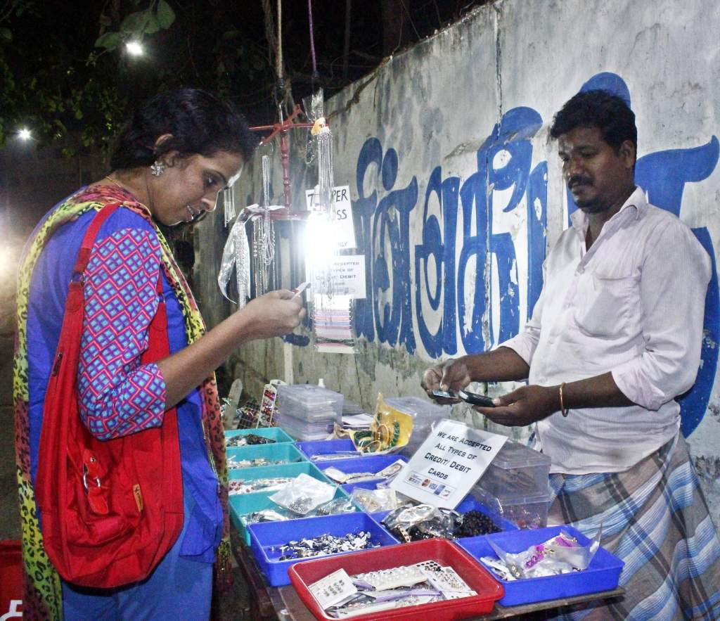 S Mahesh using a card swipe machine to receive payment from a customer in the city on Saturday | Shri krishna