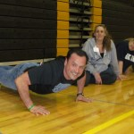 Action Auction - Who can do the most pushups for bonus points? Manny Gonzalez