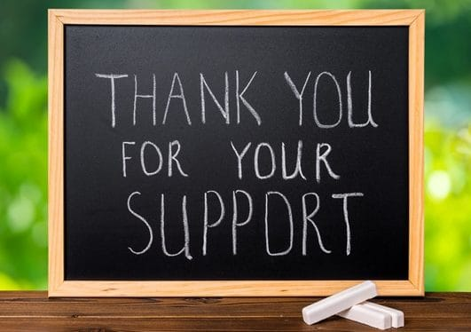 thank you for your support written on chalkboard