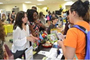 students getting information at campus club fair