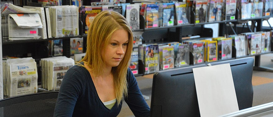 Female student in library on the computer