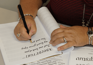 Calligraphy student practicing writing skills