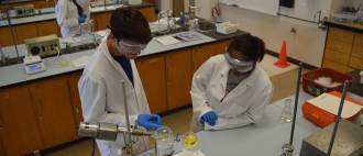 Students working in a lab setting