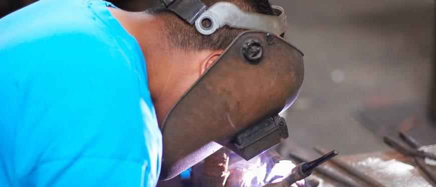 Male student welding