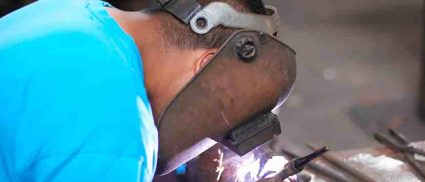 Male student welding