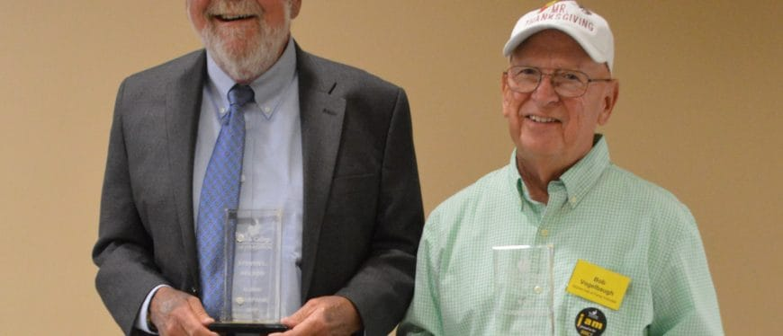 Steven Nelson and Bob Vogelbaugh with awards