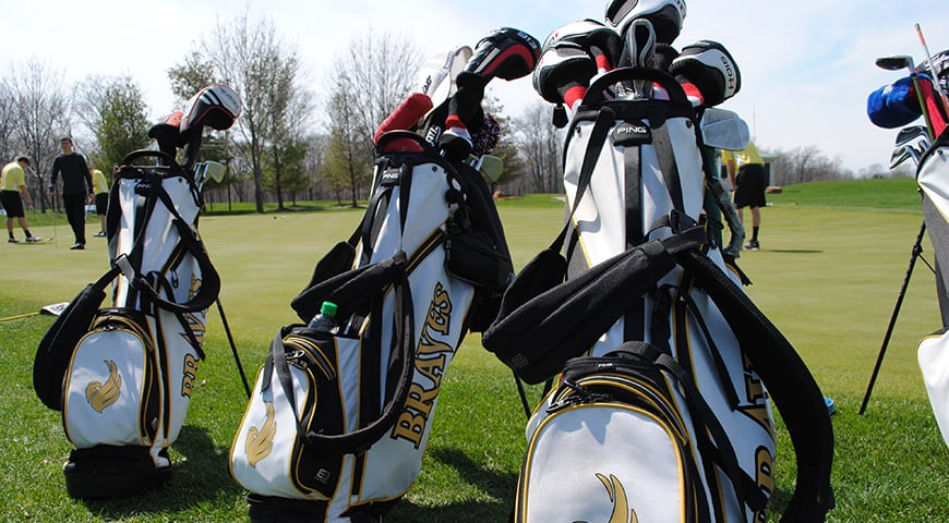 Golf bags lined up at the course
