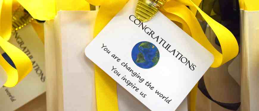 white gift bag with yellow ribbon & congratulations note