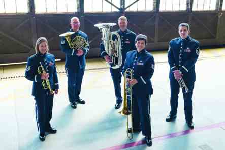5 Air Force musicians in uniform holding brass instruments