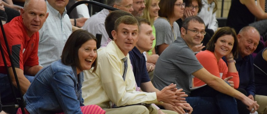 group of employees enjoying fall assembly day