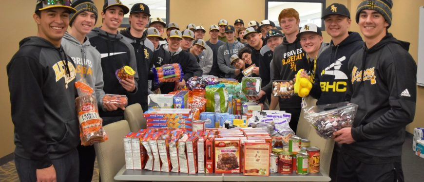 Students helping stock food pantry