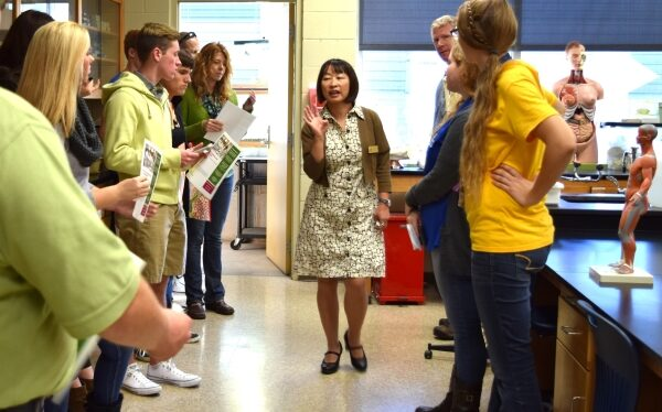 Faculty member giving a tour of a science lab